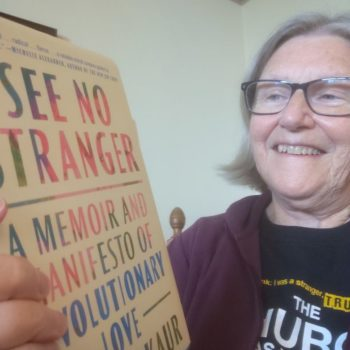 Sister Simone Campbell with See No Stranger book